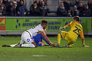 Peterborough United defender Rhys Bennett (16) bringing down AFC Wimbledon defender Steve Seddon (15) for a penalty and then red card, sent off during the EFL Sky Bet League 1 match between AFC Wimbledon and Peterborough United at the Cherry Red Records Stadium, Kingston, England on 12 March 2019.