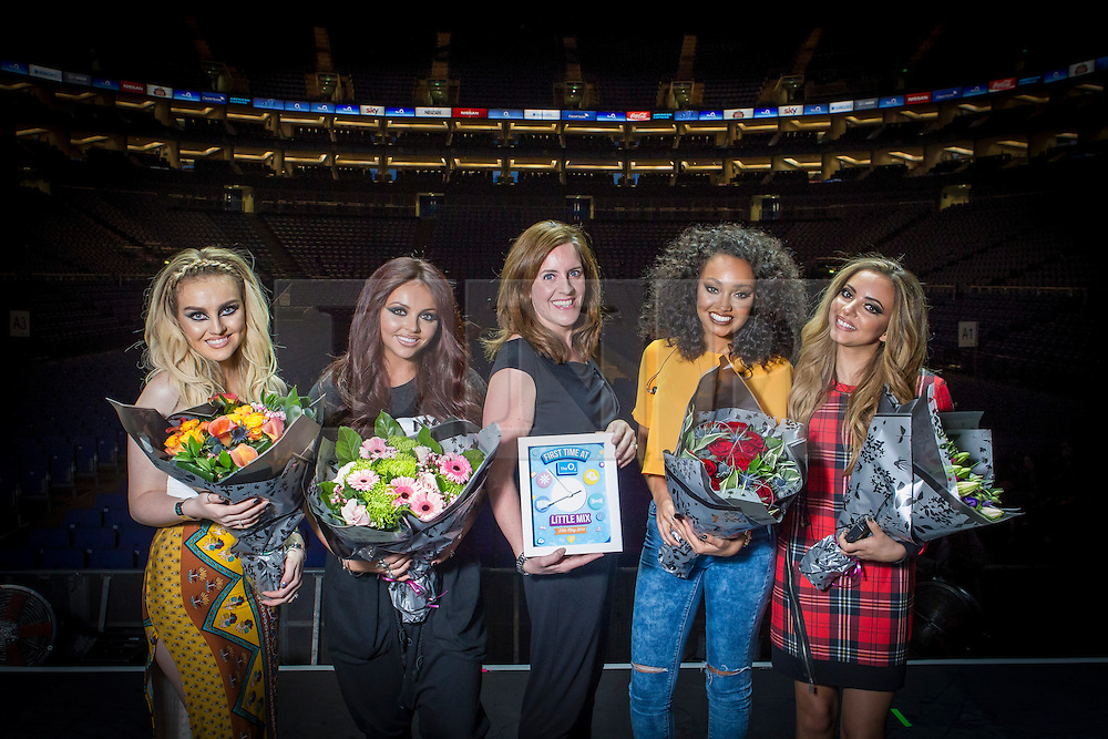 © Licensed to London News Pictures. 25/05/2014. London, UK. To celebrate their first ever headline show at The O2, girl group Little Mix were presented with a special award by the venue's general manager Rebecca Kaneon stage prior to their performance on Sunday 25 May. The bespoke award features the band's name and the exact time the band were due to perform on stage. Photo credit : David Fearn/LNP