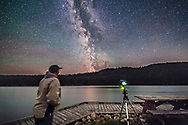 A selfie at Reesor Lake in Cypress Hills with the Milky Way, July 29, 2017, with the Canon 6D at ISO 6400 and 14mm Rokinon SP at f/2.5. The camera is shooting a panning time-lapse with the SYRP Genie Mini. A dark frame is included for demo purposes. The dark frame was taken immediately afterwards but is a single dark.