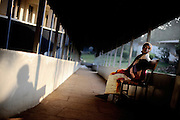 Outreach Centre Fistula Hospital, Yirgalem, Ethiopia - the walkway leads up to the operation rooms and the ward of the hospital with 60 beds. More than 400 women have an operation here every year. They will stay at the hospital for several weeks to recuperate - as does this woman waiting for her breakfast in the morning.