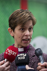 © Licensed to London News Pictures . 09/02/2015 . Manchester , UK . LIBBY LANE , the Bishop of Stockport , carries out her first public engagement since being ordained as the first woman Bishop in the Church of England . Pictured being interviewed by media . Bishop Libby Lane meets victims of human trafficking at Manchester Airport's Terminal 2 Arrival Lounge and speaks in support of efforts to clamp down on human trafficking . Photo credit : Joel Goodman/LNP