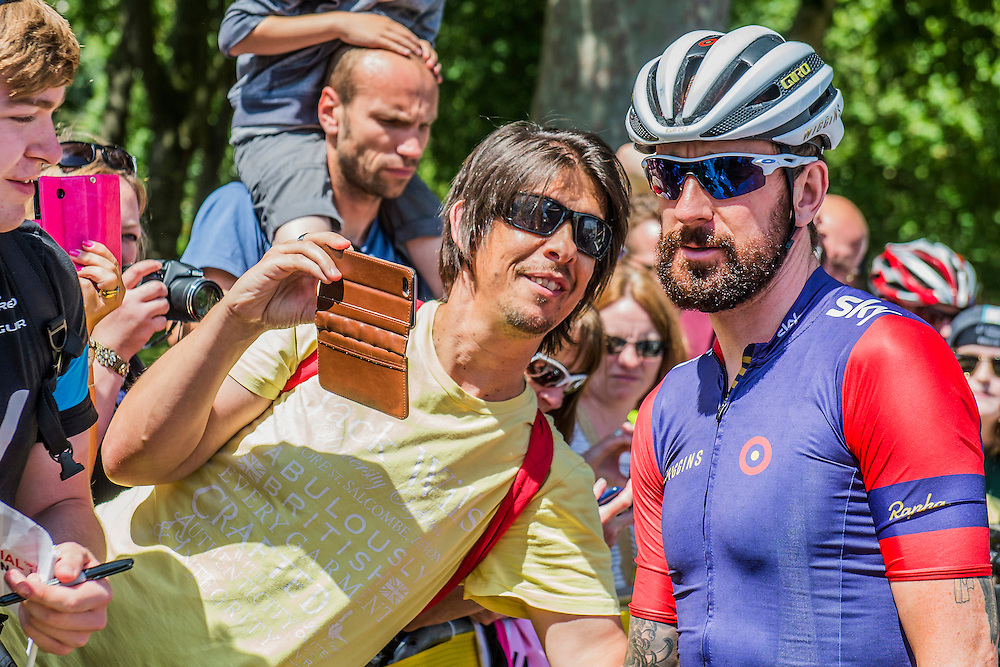 Bradley Wiggins signs autographs for fans - The London-Surrey Classic professional race. Prudential RideLondon a festival of cycling, with more than 95,000 cyclists, including some of the world's top professionals, participating in five separate events over the weekend of 1-2 August.