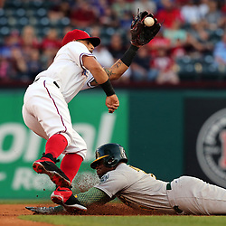 May 12, 2017 - Arlington, TX, USA - Texas Rangers second baseman Rougned Odor (12) gets the throw from home as Oakland Athletics' Rajai Davis (11) tries to steal second in the first inning on Friday, May 12, 2017 at Globe Life Park in Arlington, Texas. (Credit Image: © Richard W. Rodriguez/TNS via ZUMA Wire)