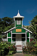 A view of the Ierusalema Hou Church surrounded by lush, tropical foliage in Halawa Valley on the island of Molokai, Oahu.