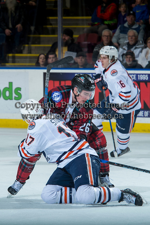 KELOWNA, CANADA - MARCH 10: Liam Kindree #26 of the Kelowna Rockets checks Brodi Stuart #17 of the Kamloops Blazers  on March 10, 2018 at Prospera Place in Kelowna, British Columbia, Canada.  (Photo by Marissa Baecker/Shoot the Breeze)  *** Local Caption ***