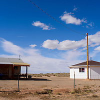 New power lines and poles stand outside a home a hogan in Greasewood Springs Tuesday.