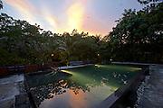 Thailand, Ko Kradan. The Sevenseas Resort. The pool at sunset.