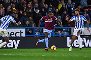 Michail Antonio of West Ham United (30) charges forward with the ball during the Premier League match between Huddersfield Town and West Ham United at the John Smiths Stadium, Huddersfield, England on 10 November 2018.
