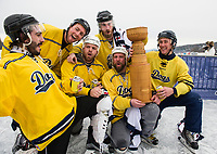 The Dogs III win the coveted trophy in the Open division during Sunday's championship round of the New England Pond Hockey Classic. (Karen Bobotas/for the Laconia Daily Sun)