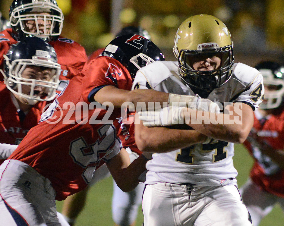DOYLESTOWN, PA - OCTOBER 17: Truman's Hunt Trysten #44 runs with the football in the first quarter as Central Bucks East's Dustin Buchanan #38 tackles him at War Memorial Stadium October 17, 2014 in Doylestown, Pennsylvania. (Photo by William Thomas Cain/Cain Images)