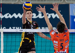 Mariusz Wlazly of Belchatow vs Alen Sket of ACH during volleyball match between ACH Volley LJUBLJANA and  PGE Skra Belchatow (POL) of 2012 CEV Volleyball Champions League, Men, League Round in Pool F, 4th Leg, on December 20, 2011, in Arena Stozice, Ljubljana, Slovenia. (Photo By Grega Valancic / Sportida.com)