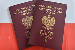 August 8, 2017 - Krakow, Poland - A view of two Polish Passports. The Ministry of Foreign Affairs of Ukraine has considered as an 'unfriendly step' to place inside the new Polish passport a graphic design with the motif of the Lviv Eaglets' Cemetery. The Polish Ambassador in Kiev, Jan Pieklo, received a diplomatic note on the matter...'We wanted to pay tribute to all those who poured blood for the freedom of Poland, all those who contributed to the fact that Poland after 123 years of slavery went to independence' - said Mariusz Blaszczak from the Polish Ministry of Interior and Administration, on 28 July, 2017  at the launch of the 'Design with us Polish Passport 2018' campaign. On Tuesday, August 9, 2017, in Krakow, Poland. (Credit Image: © Artur Widak/NurPhoto via ZUMA Press)