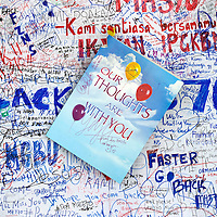 A message card is pasted on wall of hope at Kuala Lumpur International Airport in Sepang, Selangor, Malaysia 25 March 2014. Malaysian Prime minister Najib Razak announces that Malaysian missing airlines MH370 has ended in south Indian Ocean on 24 March 2014.