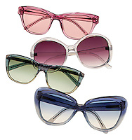 A group of 4 translucent sunglasses photographed on white.
