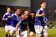 Korey Smith of Oldham Athletic (2nd right) celebrates scoring his first goal of the game to make it 1-1 during the Sky Bet League 1 match at the Matchroom Stadium, London<br /> Picture by David Horn/Focus Images Ltd +44 7545 970036<br /> 25/03/2014