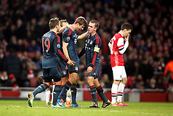 19.02.2014, Emirates Stadion, London, ENG, UEFA CL, FC Arsenal vs FC Bayern Muenchen, Achtelfinale, im Bild vl: Mario Goetze (FC Bayern Muenchen #19), Torschuetze Thomas Mueller (FC Bayern Muenchen #25), Kapitaen, Captain Philipp Lahm (FC Bayern Muenchen #21), der enttaeuscht Laurent Koscielny (Arsenal FC #6) beim Torjubel nach dem 2:0, Emotion, Freude, Glueck, Positiv // during the UEFA Champions League Round of 16 match between FC Arsenal and FC Bayern Munich at the Emirates Stadion in London, Great Britain on 2014/02/19. EXPA Pictures © 2014, PhotoCredit: EXPA/ Eibner-Pressefoto/ Schueler<br /> <br /> *****ATTENTION - OUT of GER*****