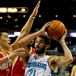 Jan 9, 2013; New Orleans, LA, USA; New Orleans Hornets point guard Greivis Vasquez (21) is defended by Houston Rockets point guard Jeremy Lin (7) during the first quarter of a game at the New Orleans Arena. Mandatory Credit: Derick E. Hingle-USA TODAY Sports