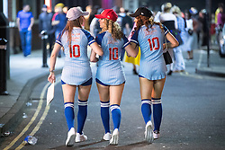 """© Licensed to London News Pictures . 27/12/2016 . Wigan , UK . Three women wearing baseball uniforms with """"Out of your league 10"""" printed across their backs . Revellers in Wigan enjoy Boxing Day drinks and clubbing in Wigan Wallgate . In recent years a tradition has been established in which people go out wearing fancy-dress costumes on Boxing Day night . Photo credit : Joel Goodman/LNP"""