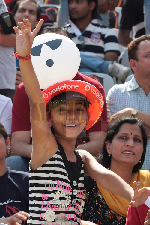 A girl enjoying during match 9 of the Indian Premier League ( IPL ) Season 4 between the Kings XI Punjab and the Chennai Super Kings held at the PCA stadium in Mohali, Chandigarh, India on the 13th April 2011..Photo by Anil Dayal/BCCI/SPORTZPICS