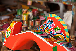 Sarchi, Central Highlands: The yoke of a new ox-cart in painting stage at the Sarchi Crafts Center, Sarchi, Costa Rica.  The primary crafts and furniture building center for Costa Rica, this small town is famous for its colorful ox-cart designs and craftsmen.