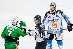 Linesman calms down Domen Vedlin (HDD Tilia Olimpija, #7) and Philipp Lukas (EHC Liwest Linz, #21) during ice-hockey match between HDD Tilia Olimpija and EHC Liwest Black Wings Linz at second match in Semifinal  of EBEL league, on March 8, 2012 at Hala Tivoli, Ljubljana, Slovenia. (Photo By Matic Klansek Velej / Sportida)
