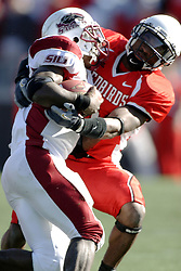 14 October 2006: Kye Stewart wraps up Arkee Whitlock. The 6th largest crowd at Hancock Stadium came to watch a game that put 8th ranked Southern Illinois Salukis against 5th ranked Illinois State University Redbirds.  The Redbirds stole the show for a Homecoming win by a score of 37 - 10. Competition commenced at Hancock Stadium on the campus of Illinois State University in Normal Illinois.<br />