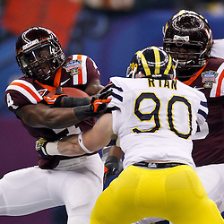 January 3, 2012; New Orleans, LA, USA; Michigan Wolverines linebacker Jake Ryan (90) pursues Virginia Tech Hokies running back David Wilson (4) during the first quarter of the Sugar Bowl at the Mercedes-Benz Superdome.  Mandatory Credit: Derick E. Hingle-US PRESSWIRE