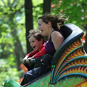 A mother and son enjoy a roller coaster during the May Fair at Saint Mark's Church, New Canaan, Connecticut, USA. 12th May 2012. Photo Tim Clayton