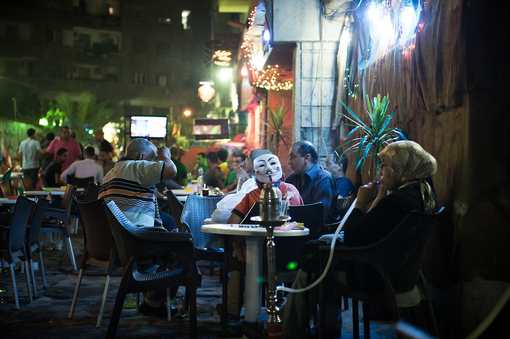 People sitting in a shisha bar in downtown in Cairo, Egypt, July 3, 2013