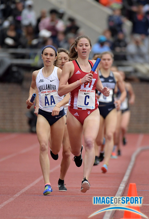 Apr 27, 2018; Philadelphia, PA, USA; Kelsey Harris runs the second leg on the Indiana women's 4 x 1,500m relay that placed second in 17:41.32 during the 124th Penn Relays at Franklin Field.