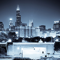 Chicago skyline at night blue toned with downtown city buildings and Lake Share Drive. Photo is high resolution and was taken in late 2011.