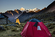 Day 3 of 10: Sunrise light strikes  Nevados Chacraraju (20,039 ft or 6108 m) over our tent camp in Huaripampa Valley at 13,780 ft or 4200 m elevation. Trek 10 days around Alpamayo in Huascaran National Park (UNESCO World Heritage Site), Cordillera Blanca, Andes Mountains, Peru, South America.