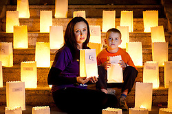 Repro Free: 25/20/2010 Andrew Whyte (8) is pictured with cancer survivor Lorna Rice during a Candle of Hope ceremony to mark the launch of the Global Relay For Life European Summit which is being hosted by the Irish Cancer Society in Dublin today. Pic Andres Poveda..The Global Relay For Life European Summit is an international symposium focusing on how ?We Save Lives? through Relay For Life in communities across the globe. Relay For Life is a 24 hour community celebration event which sees teams of participants take to the track overnight to symbolise the fact that cancer never sleeps. The Irish Cancer Society was chosen this year to host the Summit, which is organised by the American Cancer Society, from the 25th-27th of October 2012....To find out more about Relay For Life, visit www.relayforlife.ie or call 1850 60 60 60. ..ENDS. .For further information, please contact:.Grainne O'Rourke / Órla Sheils.Communications, Irish Cancer Society.E: gorourke@irishcancer.ie / osheils@irishcancer.ie .T: 01 231 0546 / 01 231 055 / 087 9707709
