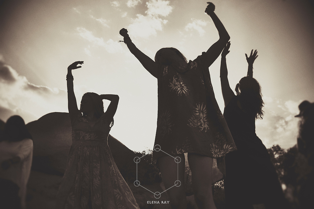 Contemporary wise woman spirit. Women dancing under the open sky. Sepia toned black and white photograph. Fine Art Photography
