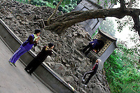 Women pray and make offerings at Ngoc Son Temple.