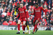 Liverpool midfielder Jordan Henderson (14) and Liverpool midfielder Georginio Wijnaldum (5) during the Premier League match between Liverpool and Watford at Anfield, Liverpool, England on 14 December 2019.
