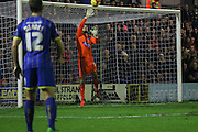Mark Cousins (goalkeeper) of Dagenham & Redbridge tips George Francomb of AFC Wimbledon's free kick over the bar during the Sky Bet League 2 match between AFC Wimbledon and Dagenham and Redbridge at the Cherry Red Records Stadium, Kingston, England on 24 November 2015. Photo by Stuart Butcher.