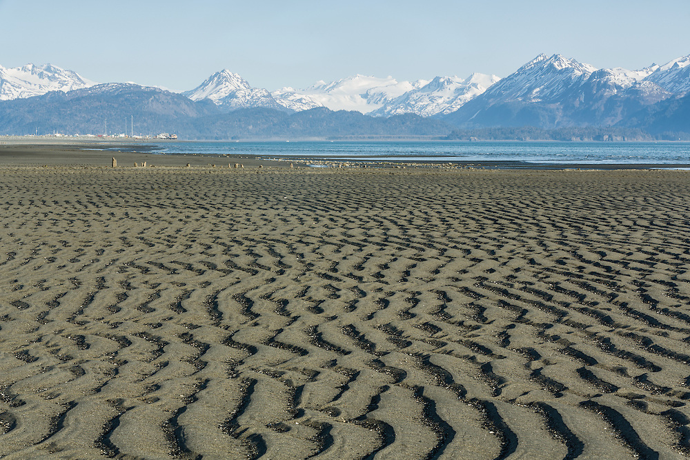 Focus stacking composite of low tide patterns in sand and Kachemak Bay along the Homer Spit in Homer in Southcentral Alaska. Spring. Evening.