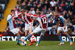 Stoke Forward Peter Crouch (ENG) is challenged by Aston Villa Midfielder Marc Albrighton (ENG) - Photo mandatory by-line: Rogan Thomson/JMP - 07966 386802 - 23/03/2014 - SPORT - FOOTBALL - Villa Park, Birmingham - Aston Villa v Stoke City - Barclays Premier League.
