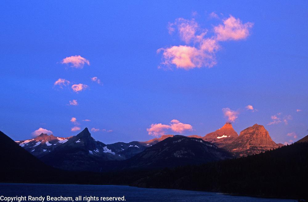 Saint Mary Lake and the Rocky Mountains at sunrise. Glacier National Park, Montana