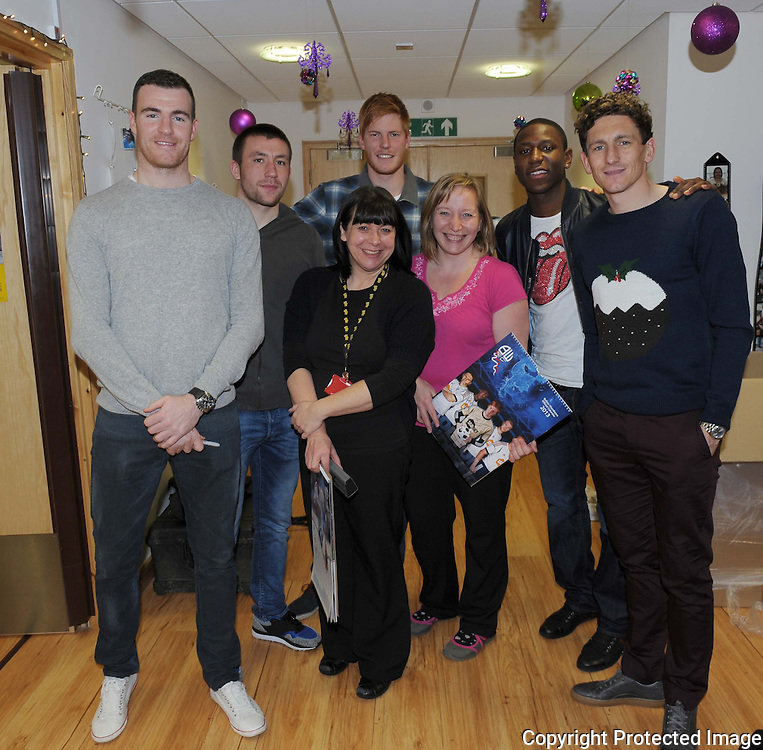 Football-Bolton Wanderers Hospital Visit-Derian House Chorley-20/12/2012-Pictures by Paul Currie-Keep-Andy Lonergan Jay Lynch Adam Bogdan Benik Afobe and Keith Andrews with staff at Derian House hospice in Chorley Lancashire