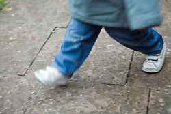 Toddler's feet running,