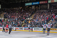 KELOWNA, CANADA - APRIL 14: Dillon Dube #19, Gordie Ballhorn #4 and Devante Stephens #21 of the Kelowna Rockets celebrate a goal against the Portland Winterhawks on April 14, 2017 at Prospera Place in Kelowna, British Columbia, Canada.  (Photo by Marissa Baecker/Shoot the Breeze)  *** Local Caption ***