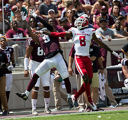 Texas A&M wide receiver Hezekiah Jones (9) misses a pass as Louisiana-Lafayette defensive back Simeon Thomas (8) defends during the third quarter of an NCAA college football game Saturday, Sept. 16, 2017, in College Station, Texas. (AP Photo/Sam Craft)