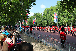 © Licensed to London News Pictures. 09/06/2018. London, UK. Guardsmen parade down The Mall as Royal fans wait to see members of the Royal family attend the Trooping The Colour ceremony in London to mark the 92nd birthday of Queen Elizabeth II, Britain's longest reigning monarch. Photo credit: Rob Pinney/LNP