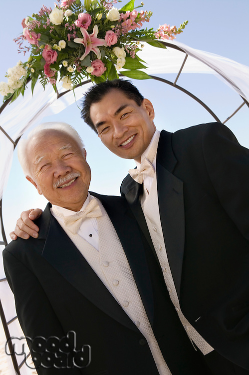 Groom With Father Under Archway