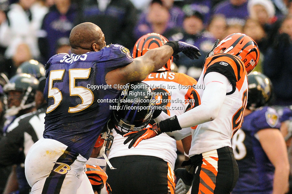 Jan. 2, 2011 - Baltimore, Maryland, United States of America - Baltimore Ravens linebacker Terrell Suggs (55) takes a swing at Cincinnati Bengals wide receiver Jerome Simpson (89) during the second half of Sunday afternoon's game at M&T Bank Stadium in Baltimore, MD. The Ravens defeated the Bengals 13-7