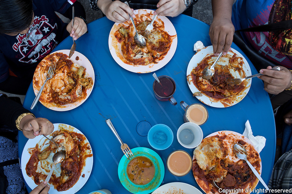 Group breakfast or roti canai and curry chicken on Transfer Road, George Town, Malaysia