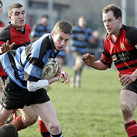 Shannon's Matthew Costello manages to get past Ennis' Brian Frawley and Robbie Madden during their Munster Junior Cup clash in Ennis Rugby Grounds on Sunday.<br /> <br /> Photograph by Yvonne Vaughan.