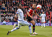 Bournemouth Midfielder Junior Stanislas (19) takes on Chelsea Defender Baba Rahman (6) during the Barclays Premier League match between Bournemouth and Chelsea at the Goldsands Stadium, Bournemouth, England on 23 April 2016. Photo by Adam Rivers.